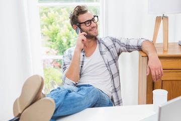 Calm casual businessman having a phone call