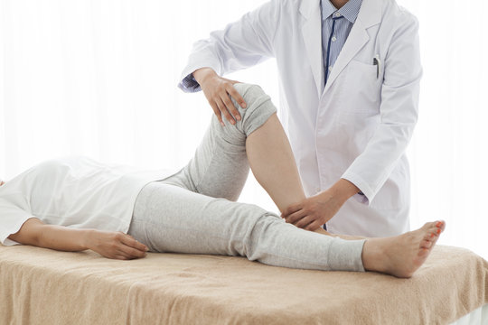 Orthopedic surgeon, has been testing a woman's legs