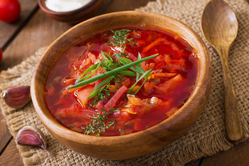 Traditional Ukrainian Russian vegetable borscht soup on the old wooden background