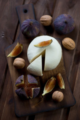 Adygea cheese, fresh fig fruits and walnuts, view from above