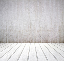 Empty room with white wall texture background and wooden floor.
