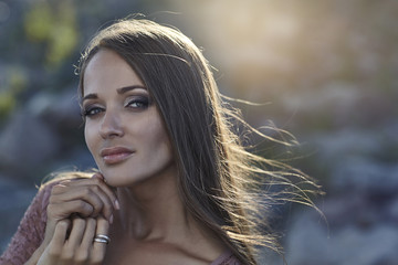 Portrait of a female model beauty outdoors in the sunlight