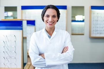 A female optician arm crossed