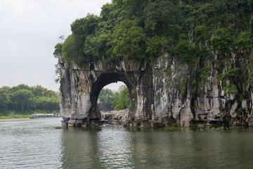 karst cave at the river bank