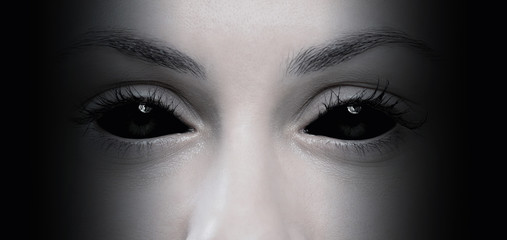 Halloween concept, close up of evil female eyes Wall mural