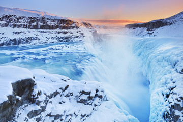 Fototapete - Frozen Gullfoss Falls in Iceland in winter at sunset