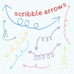 Set of colorful doodle arrows on a background of notebook sheet