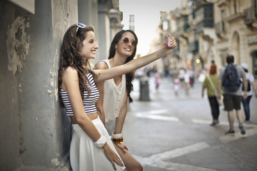 Two beautiful girls doing a selfie