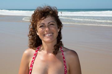 Sunshine woman Portrait. Happy Woman Smiling
