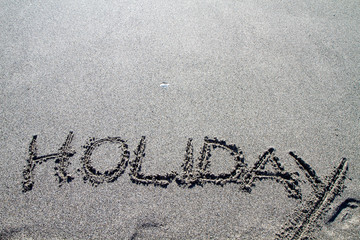 words written on the pebble beach, holiday