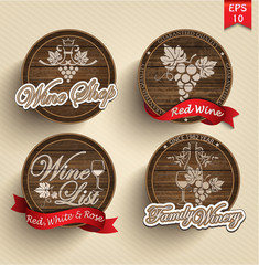 four labels for wine on wooden casks with red ribbons.