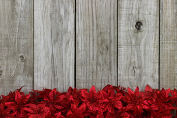 Red garland border with rustic wood background