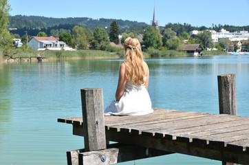 Girl on the wooden jetty. Switzerland