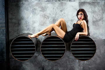 Wall Mural - Portrait Of Sexy Woman On a dark metallic Background