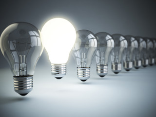 Idea or uniqueness, originality concept. Row of light bulbs with