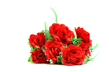 Artificial red roses on a white background