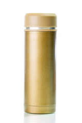 Gold metal thermos isolated on white background