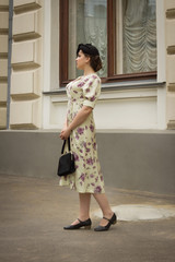 Very beautiful soviet girl in retro style is on the Moscow stree