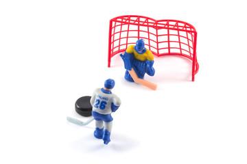 Toy hockey players playing hockey