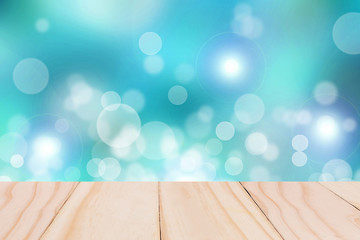 Light bokeh background with wooden paving.