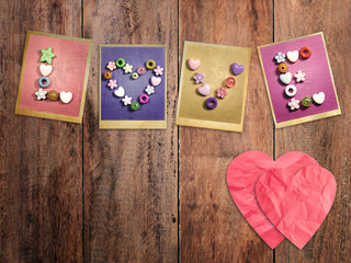 Red hearts and LOVE word put on wood background.
