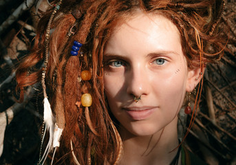 Close up Woman Face with Dreadlocks and Piercing