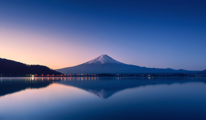 mountain Fuji at dawn with peaceful lake reflection
