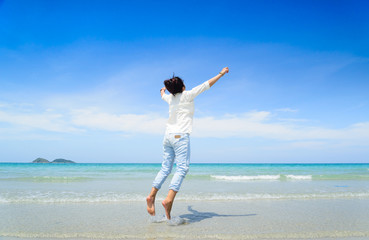 woman Jumping on The Beach. Travel and Vacation. Freedom Concept