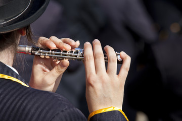 Playing a flute.