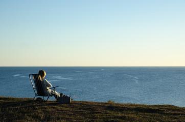 Sitting by seaside