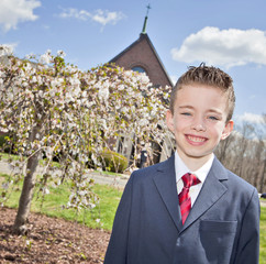 Boy outside church