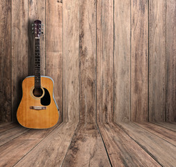 Guitar in old room.