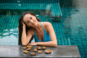 young brunette woman in the pool