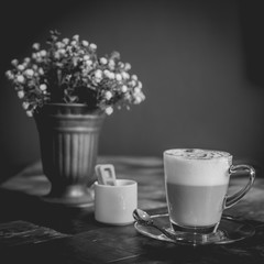 Hot art Latte Coffee in a cup on wooden table, black and white e