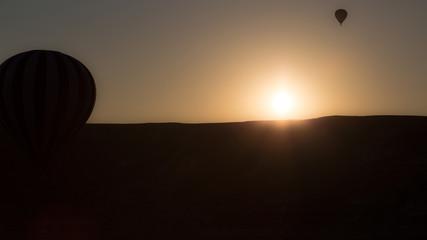 Golden Sunrise in cappadocia with balloons