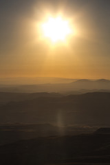 Golden sun over mointains and rocks in cappadocia