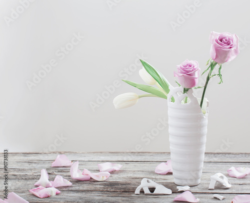 Pink Roses In Broken Vase On Old Wooden Table Stock Photo And