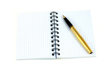 Spiral notebook and golden fountain pen isolated on white closeup
