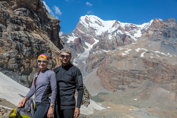 Excited Travelers Young Man and Woman Traveling Outdoor Expressing Fun and Pleasure Casual Sporty Style Clothing Majestic Himalaya Mountain Landscape on Background