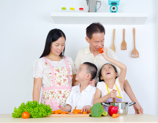 Asian family cooking in the kitchen