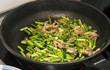 Stir frying green vegetables with ground beef