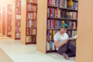 library blur background with student and bookshelf