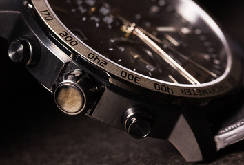 Closeup of man watch on a black background