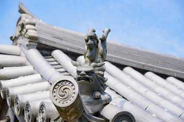 traditional japanese steel lion statue on the roof