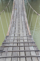 The Old Wooden Long Pendant Rope Bridge cross the stream, on nat