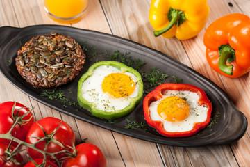 Aluminium Prints Egg Fried eggs in peppers