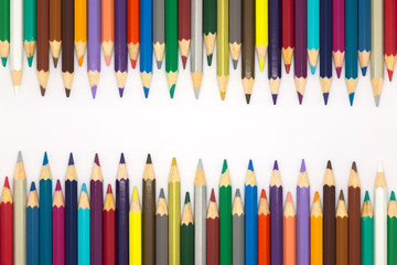 Drawing colorful wooden pencils on white background