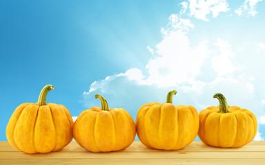 group of pumpkin on blue sky background