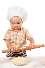 Cute kid rolls cook pizza dough. Isolated on white