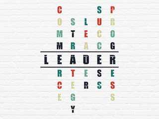 Finance concept: word Leader in solving Crossword Puzzle
